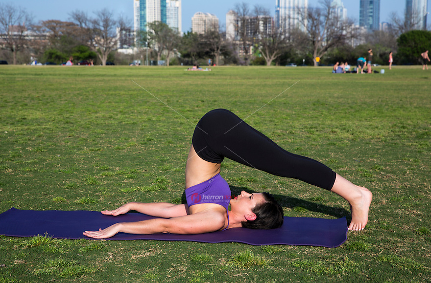 Zilker Park is Austin's favorite location to practice yoga and meditate on the park's lush green grass and lawns.