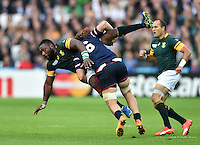 Tendai Mtawarira of South Africa is tackled by Daniel Barrett of the USA. Rugby World Cup Pool B match between South Africa and the USA on October 7, 2015 at The Stadium, Queen Elizabeth Olympic Park in London, England. Photo by: Patrick Khachfe / Onside Images