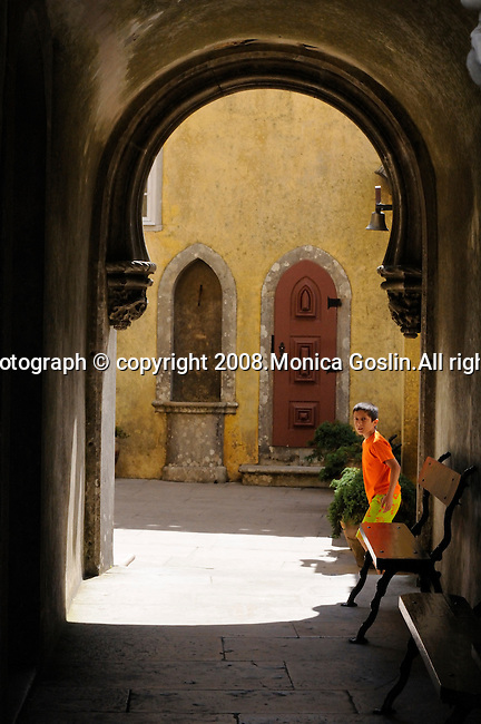 A boy runs through a courtyard at the Pena National Palace in Sintra, Portugal.