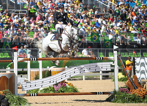 14.08.2016. Rio de Janeiro, Brazil. Emanuele Gaudiano of Italy on horse Caspar 232 clears an obstacle during the Jumping Individual 1st Qualifier of the Equestrian competition at the Olympic Equestrian Centre during the Rio 2016 Olympic Games in Rio de Janeiro, Brazil, 14 August 2016.