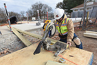 NWA Democrat-Gazette/FLIP PUTTHOFF <br />PEA RIDGE SPLASH PARK<br />Dean De Candia works Wednesday Nov. 28 2019 on a splash park being built at Pea Ridge Citiy Park. The splash park will have 20 nozzles, water features and showers, said Rick Campbell with Ellington Contracting. The park will be ready to open in the spring.