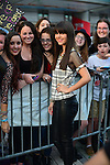 SUNRISE, FL - DECEMBER 21: Actress/singer Elizabeth Elias poses with fans backstage at Y100's Jingle Ball Village, Y100's Jingle Ball 2014 official pre-show at BB&T Center on December 21, 2014 in Sunrise, Florida.  (Photo by Johnny Louis/jlnphotography.com)