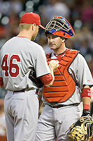 Philadelphia Phillies catcher Brian Schneider talks with pitcher Ryan Madson (46) against the Houston Astros on Turn Back the Clock Nite. Game played on Saturday April 10th, 2010 at Minute Maid Park in Houston, Texas.  (Photo by Andrew Woolley / Four Seam Images)