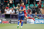 Olympique Lyonnais's Sarah Bouhaddi (l) and Saki Kumagai celebrate the victory in the UEFA Women's Champions League 2015/2016 Final match.May 26,2016. (ALTERPHOTOS/Acero)