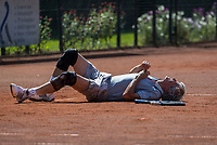 Etten-Leur, The Netherlands, August 27, 2017,  TC Etten, NVK, Hans Adama Van Scheltema (NED) goes down on the clay and huts himself<br /> Photo: Tennisimages/Henk Koster