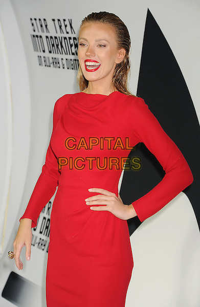 Bar Paly<br /> &quot;Star Trek Into Darkness&quot; DVD/Blu-Ray Release held at the California Science Center, Los Angeles, California, USA.<br /> September 10th, 2013<br /> half length dress hand on hip red hair slicked back mouth open smiling lipstick <br /> CAP/ROT/TM<br /> &copy;Tony Michaels/Roth Stock/Capital Pictures