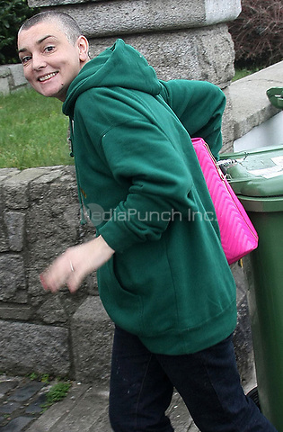 DUBLIN, IRELAND - JANUARY 04:  Irish musician Sinead O'Connor seems to have quickly changed her mind about divorcing her 4th husband, Barry Herridge.  Earlier today, Sinead tweeted that her and her new husband are back together.  The pair were spotted taking in the Greenstar bins at her home in Bray, Co. Wicklow. Sinead was more than happy for the photographers to snap pictures of the smile on her face, while Barry looked more serious and downcast.    on January 4, 2012 in Dublin, Ireland<br /><br />People:  Sinead O'Connor, Barry Herridge<br /><br />Transmission Ref:  MNCUK1<br /><br />Credit: Hoo-Me.com/MediaPunch
