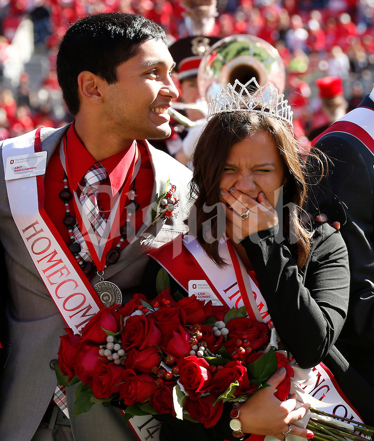 Ohio State University student Lisa Combs reacts to being named the 2015 Homecoming Queen before Saturday's NCAA Division I football game against Maryland at Ohio Stadium in Columbus on October 10, 2015. (Dispatch Photo by Barbara J. Perenic)