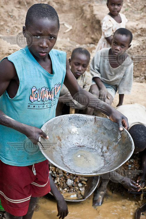Children working in the gold mines of northern Tanzania. Mercury, which is highly poisonous, is used to separate gold dust from mud, a process that often leads to the contamination of drinking water.