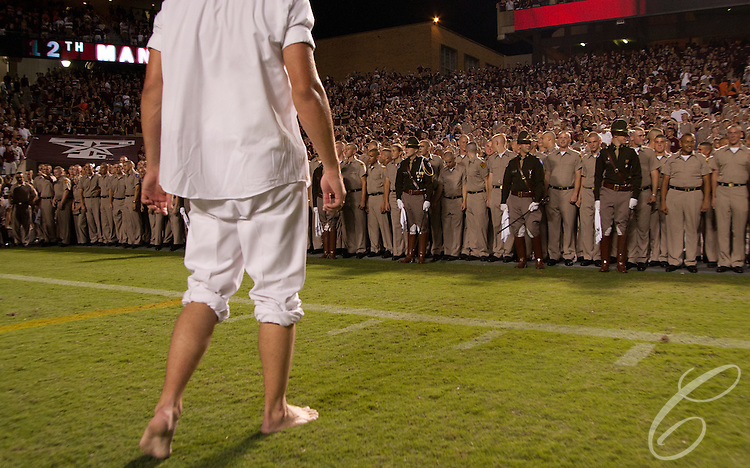 An Aggie Yell Leader prepares to run from the Corps of Cadets freshmen in the closing moments of a football game at Kyle Field in 2007.<br /> <br /> The freshmen, known as &quot;fish,&quot; chase the Yell Leaders after home victories and carry them to &quot;Fish Pond,&quot; a fountain on the A&amp;M campus, to be dunked.