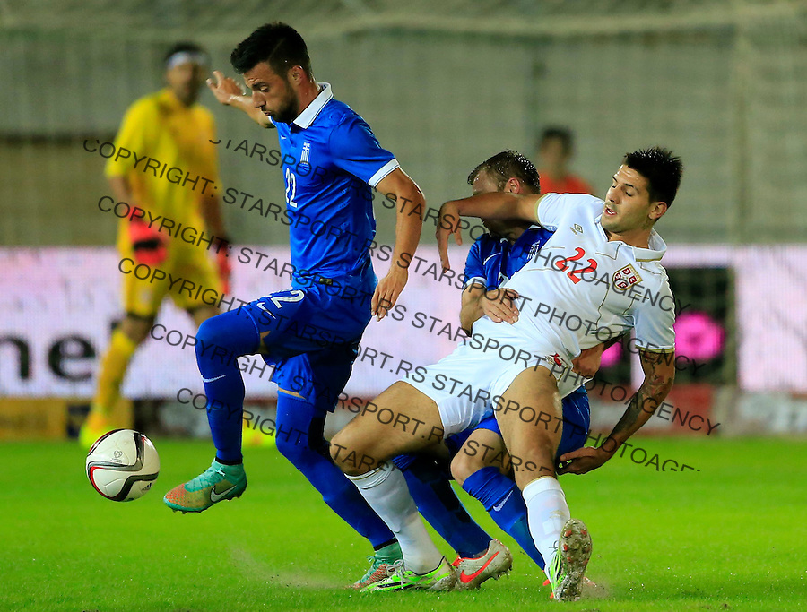 Fudbal<br /> Prijateljski mec-Friendly match<br /> Srbija v Grcka<br /> Aleksandar Mitrovic (R) and Andreas Samaris (L)<br /> Chania, 18.11.2014.<br /> foto: Srdjan Stevanovic/Starsportphoto &copy;