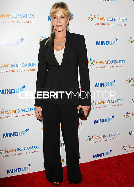 BEVERLY HILLS, CA, USA - NOVEMBER 21: Melanie Griffith arrives at Goldie Hawn's Inaugural 'Love In For Kids' Benefiting The Hawn Foundation's MindUp Program held at Ron Burkle's Green Acres Estate on November 21, 2014 in Beverly Hills, California, United States. (Photo by Celebrity Monitor)