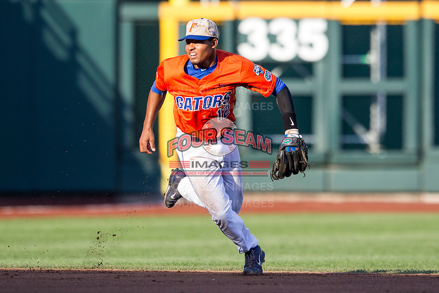 Florida Gators shortstop Richie Martin (12) on defense against the Virginia Cavaliers in Game 13 of the NCAA College World Series on June 20, 2015 at TD Ameritrade Park in Omaha, Nebraska. The Cavaliers beat the Gators 5-4. (Andrew Woolley/Four Seam Images)