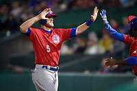 Buffalo Bisons left fielder Michael Saunders (5) high fives teammates after scoring a run to take the lead in the top of the eleventh inning during a game against the Rochester Red Wings on August 25, 2017 at Frontier Field in Rochester, New York.  Buffalo defeated Rochester 2-1 in eleven innings.  (Mike Janes/Four Seam Images)