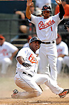 9 March 2007: Baltimore Orioles infielder Melvin Mora slides home safely to score against the Washington Nationals at Fort Lauderdale Stadium in Fort Lauderdale, Florida. <br /> <br /> Mandatory Photo Credit: Ed Wolfstein Photo