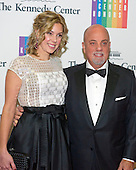 Billy Joel and Alexis Roderick arrive for the formal Artist's Dinner honoring the recipients of the 2013 Kennedy Center Honors hosted by United States Secretary of State John F. Kerry at the U.S. Department of State in Washington, D.C. on Saturday, December 7, 2013. The 2013 honorees are: opera singer Martina Arroyo; pianist,  keyboardist, bandleader and composer Herbie Hancock; pianist, singer and songwriter Billy Joel; actress Shirley MacLaine; and musician and songwriter Carlos Santana.<br /> Credit: Ron Sachs / CNP