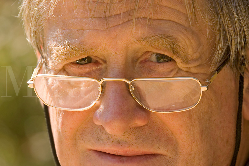 Portrait of man, 60 years old, outside. Wearing glasses. Released.