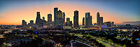 Houston Skyline pano as the sunrise was just showing some color behind the city giving it this nice glow.  This Houston Cityscape panorama show off all the city tallest skycrapers in this compact downtown view. The  Houston skyline has sone of the tallest buildings in the southern US. In this image you can see the Heritage Plaza, Chevron, Wells Fargo and the tallest building in Houston the J P Morgan Chase Tower at 1002 ft and it is the 17 tallest in the US. Houston is the seat of Harris county and was founded in 1837 near the banks of the Buffalo Bayou or Allen Landing as it is called today. The city was name after General San Houston after he won the battle of San Jacinto. Houston has been a growing city because of the port of houston and railroads along with oil boom from the early 1901. Houston has other industry that have made it thrive in america such as energy, manufacturing, aeronautics, and transportation. Also NASA mission control is located in the city. Houston has also taken the lead on health care with many people coming to the Medical Center for top notch doctors and hospital with the latest advancement in medical care.