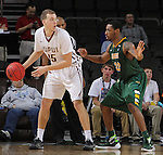 SIOUX FALLS, SD - MARCH 6:  Matt O'Leary #15 of IUPUI dribbles against Kory Brown #22 of North Dakota State in the 2016 Summit League Tournament. (Photo by Dick Carlson/Inertia)