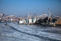 The snow and ice-covered port of Vladivostok in Russia seen from the Eastern Dream ferry.