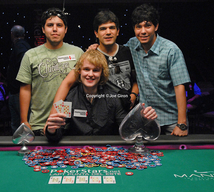 Karl Hevroy is the champion of the LAPT Season 2 Punta del Este event. Here, he poses with some of his friends.