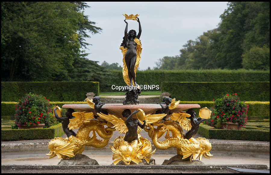BNPS.co.uk (01202 558833)<br /> Pic: PhilYeomans/BNPS<br /> <br /> All that Glisters....Is Gold! <br /> <br /> This spectacular restoration of the Mermaid Fountain at Blenheim Palace uses 8750 leaves of real gold to bring back its stunning golden hue.<br /> <br /> The ornate gilded bronze fountain has been returned to its original glory more than a century after its original installation.<br /> <br /> The Mermaid Fountain is the centrepiece of the formal Italian Garden at Blenheim Palace.<br /> <br /> Sculpted by renowned British/American artist Thomas Waldo Story it was installed at the Oxfordshire World Heritage Site by the 9th Duke of Marlborough in 1912.<br /> <br /> However over the decades the fountain became covered with a thick layer of limescale and algae and restorers used 350 books of almost pure 23 ¾ carat triple layer Old English gold to bring it back to life.<br /> <br /> The work is part of a £40 million rolling programme of conservation being carried out at the UNESCO World Heritage Site which was the birthplace of Winston Churchill.