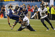 Philadelphia, PA - December 12, 2015:    Army Black Knights linebacker Andrew King (11) tackles Navy Midshipmen quarterback Keenan Reynolds (19) during the 116th game between Army vs Navy at Lincoln Financial Field in Philadelphia, PA. (Photo by Elliott Brown/Media Images International)
