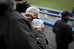 Greenock Morton 2 Stranraer 0, 21/02/2015. Cappielow Park, Greenock. A home supporter in the Shed eating a pie as Greenock Morton (in hoops) take on Stranraer in a Scottish League One match at Cappielow Park, Greenock. The match was between the top two teams in Scotland's third tier, with Morton winning by two goals to nil. The attendance was 1,921, above average for Morton's games during the 2014-15 season so far. Photo by Colin McPherson.