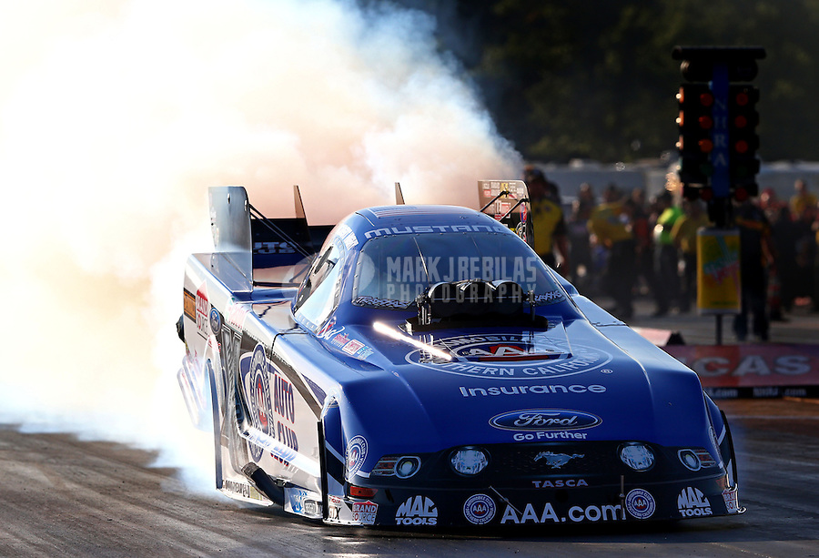 Aug. 16, 2013; Brainerd, MN, USA: NHRA funny car driver Robert Hight during qualifying for the Lucas Oil Nationals at Brainerd International Raceway. Mandatory Credit: Mark J. Rebilas-