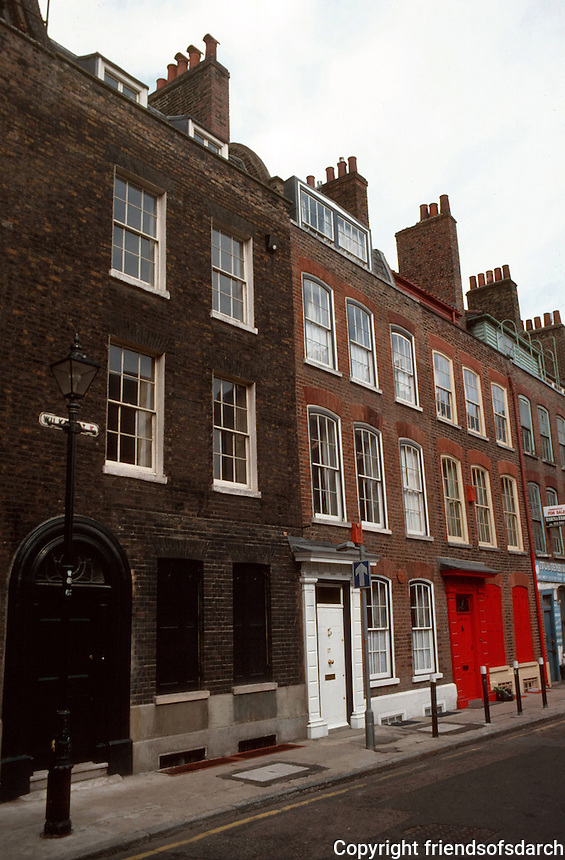 London:  Spitalfields--Wilkes St., surviving 18th century Huguenot housing stock, recently gentrified. The windows at the top were to illuminate work at the loom.  Photo '90.