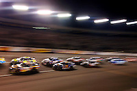 May 6, 2006; Richmond, VA, USA; A pack of cars race through turn one during the Crown Royal 400 at Richmond International Raceway. Mandatory Credit: Mark J. Rebilas-US PRESSWIRE Copyright © 2006 Mark J. Rebilas..