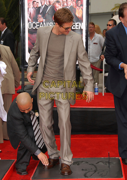 BRAD PITT.The Warner Brothers Pictures Hand & Foot Print Ceremony for The Cast of Ocean's Thirteen held at The Grauman's Chinese Theatre in Hollywood, California, USA..June 5th, 2007                     .full length beige suit stepping step sunglasses shades .CAP/DVS.©Debbie VanStory/Capital Pictures