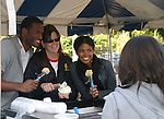 Guiding Light's actors Lawrence Saint-Victor and Karla Mosley pose with owner Stacey Jo Palas of Stacy Jo's Ice Cream as it was a tasting of a new pink Ice made especially for Young Women's Breast Cancer Awareness Foundation on October 1, 2009 in Pittsburgh, PA area as the actors visit Moon Township Honda after going to the various GO PINK Panera Bread locations. Proceeds from pink ribbon bagel sales will benefit the Young Women's Breast Cancer Awareness Foundation. (Photo by Sue Coflin/Max Photos)