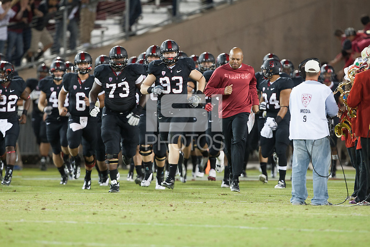 STANFORD, CA -- September 8, 2012: Team runs out onto the field at the start of the Stanford vs Duke game Saturday night at Stanford Stadium.<br /> <br /> The Cardinal defeated the Blue Devils 50-13.