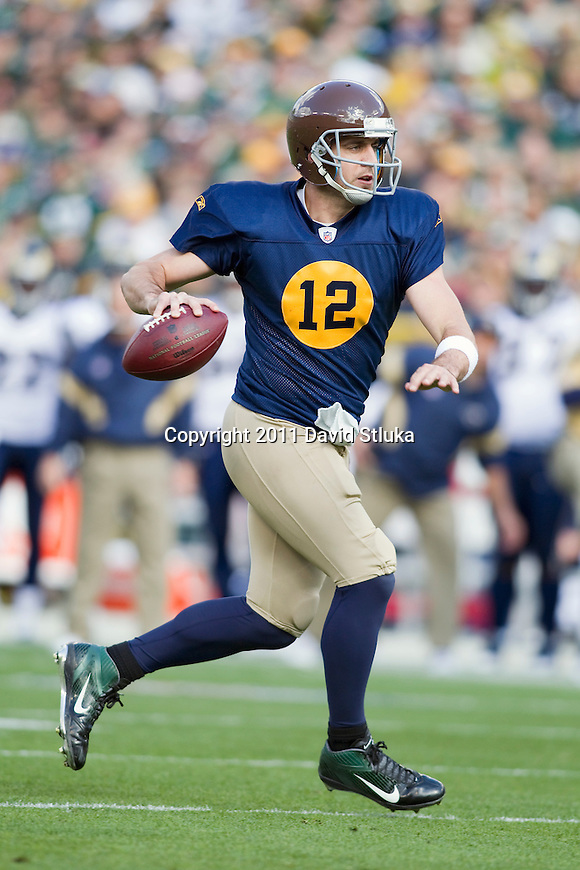 Green Bay Packers quarterback Aaron Rodgers (12) throws a touchdown pass during a Week 6 NFL football game against the St. Louis Rams on October 16, 2011 in Green Bay, Wisconsin. The Packers won 24-3. (AP Photo/David Stluka)
