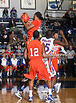 Houston Baptist Huskies forward Terry Bembry (24) grabs a rebound in the game between the UTA Mavericks and the Houston Baptist Huskies held at the University of Texas in Arlington's Texas Hall in Arlington, Texas. UTA defeats Houston Baptist 72 to 57