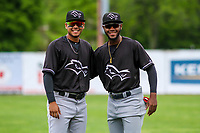 Quad Cities River Bandits shortstop Miguelangel Sierra (4) and outfielder Bryan De La Cruz (16) pose for a photo prior to a Midwest League game against the Beloit Snappers on May 20, 2018 at Pohlman Field in Beloit, Wisconsin. Beloit defeated Quad Cities 3-2. (Brad Krause/Four Seam Images)