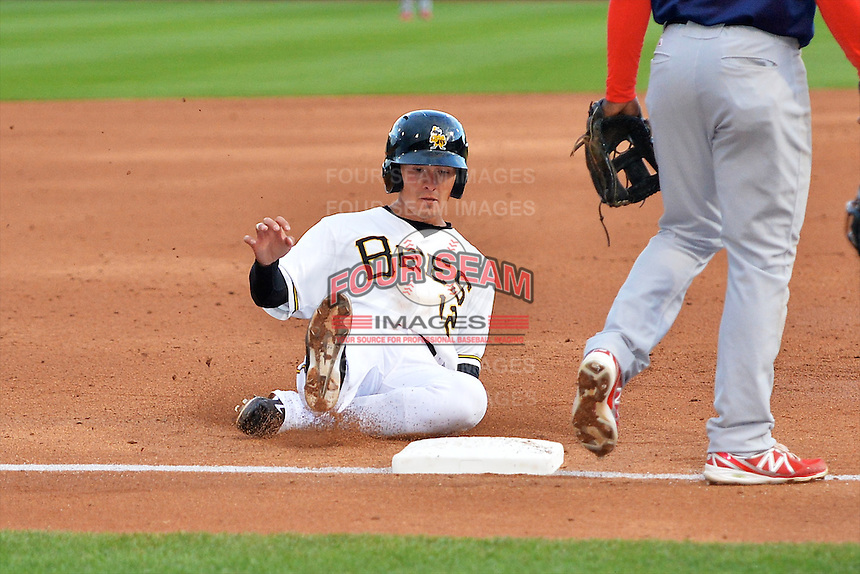 Tommy Field (12) of the Salt Lake Bees hustles towards third base against the Memphis Redbirds at Smith's Ballpark on June 18, 2014 in Salt Lake City, Utah.  (Stephen Smith/Four Seam Images)