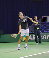 09-02-13, Tennis, Rotterdam, qualification ABNAMROWTT, Roger Feder training with his coach Luthi