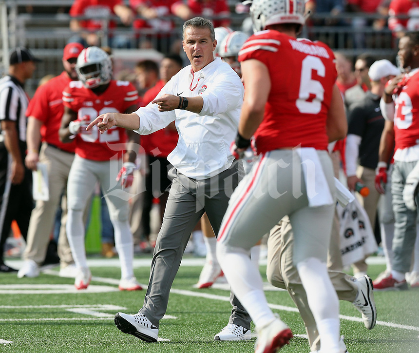 OSU head football coach Urban Meyer leads the team during warm ups before their game against Northwestern University at Ohio Stadium in Columbus, Ohio on October 29, 2016. (Columbus Dispatch photo by Brooke LaValley)