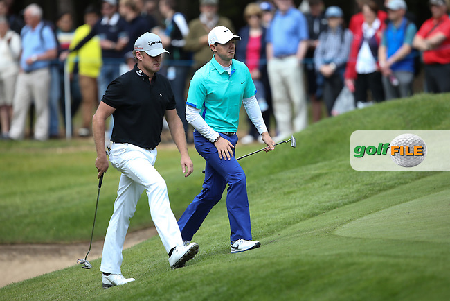 Jamie DONALDSON (WAL) and Rory MCILROY (NIR) head for the 10th  during Round One of the 2015 BMW PGA Championship over the West Course at Wentworth, Virginia Water, London. Picture David Lloyd, www.golffile.ie: 21/05/2015
