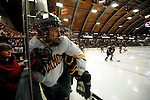 30 December 2007: University of Vermont Catamounts' forward Brayden Irwin, a Sophomore from Toronto, Ontario, is checked into the boards during a game against the Quinnipiac University Bobcats at Gutterson Fieldhouse in Burlington, Vermont. The Bobcats defeated the Catamounts 4-1 to win the Sheraton/TD Banknorth Catamount Cup Tournament...Mandatory Photo Credit: Ed Wolfstein Photo