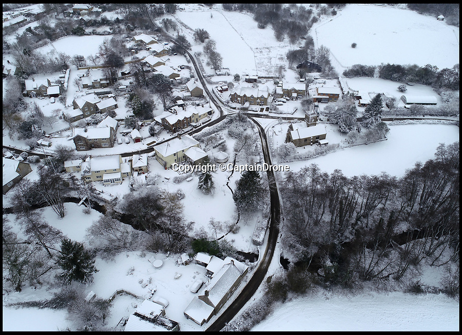 BNPS.co.uk (01202 558833)<br /> Pic: CaptainDrone/BNPS<br /> <br /> A blanket of snow covers the village of Hooke in west Dorset.