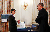 United States President Barack Obama listens to Sahil Doshi, 14 years old from Pittsburgh, Pennsylvania, who designed an innovative carbon-dioxide powered battery to reduce the environmental effects of pollution during the 2015 White House Science Fair, at the White House in Washington, DC on March 23, 2015. The White House Science Fair is a celebration of students winners of STEM (Science, technology, engineering and math) competitions from across the country on March 23, 2015, in Washington, DC. <br /> Credit: Aude Guerrucci / Pool via CNP