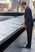 United States President Barack Obama visits the North Memorial Pool at Ground Zero on the 10th anniversary of the September 11 terrorist attacks in New York, New York on September 11, 2011. The President and First Lady are attending the Commemoration Ceremony at the National September 11 Memorial at the World Trade Center Site as they visit each of the three sites that were attacked. .Credit: Kristoffer Tripplaar / Pool via CNP