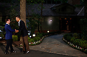 United States President Barack Obama greets Russian Prime Minister Dmitry Medvedev in front of Laurel Lodge at Camp David during the 2012 G8 Summit on Friday, May 18, 2012 in Camp David, Maryland. Leaders of eight of the worlds largest economies meet over the weekend in an effort to keep the lingering European debt crisis from spinning out of control. .Credit: Luke Sharrett / The New York Times / Pool via CNP