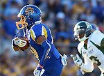 BROOKINGS, SD - SEPTEMBER 6:  Trevor Wesley #80 from South Dakota State University scampers past Jordan Williams #3 from Cal Poly for a touchdown in the first half of their game Saturday evening at Coughlin Alumni Stadium in Brookings.(Photo/Dave Eggen/Inertia)