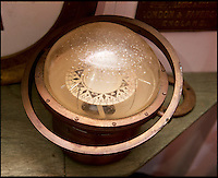 BNPS.co.uk (01202 558833)<br /> Pic: PhilYeomans/BNPS<br /> <br /> Ray Ives Locker<br /> <br /> Compass from a WW1 coal ship sunk by a mine.<br /> <br /> Old man of the sea Ray Ives has opened his very own Davy Jones' locker of hundreds of nautical treasures he has salvaged from the seabed.<br /> <br /> Ray(77) has spent 40 years amassing a huge trove of historical artefacts that he has found during thousands of deep sea dives off the British coast.<br /> <br /> Ray's watery Aladdins cave includes canon balls, muskets, swords and even the bell from an ocean liner sunk by a German U-boat in the First World War.<br /> <br /> For years Ray had stuffed his collection into a tiny shed in the back garden of his home in Plymouth, Devon.<br /> <br /> But now the fascinating archive has now gone on display to the public in a ramshackle museum made from shipping containers.