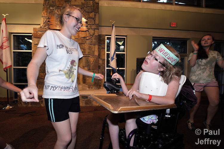 Counselor Amber Malik (left) dances with camper Ashley Franke (in wheelchair) during an evening dance party at Camp Aldersgate in Little Rock, Arkansas. The camp, supported by United Methodist Women, offers children suffering from a variety of disabilities a safe and fun experience similar to that which normally-abled children often enjoy.