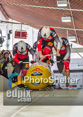 9 January 2016: Swiss pilot Rico Peter leads his 4-man team as they push off their first run of the day at the BMW IBSF World Cup Bobsled Championships at the Olympic Sports Track in Lake Placid, New York, USA. Peter's team came in 5th for the day, with a 2-run combined time of 1:50.13. Mandatory Credit: Ed Wolfstein Photo *** RAW (NEF) Image File Available ***